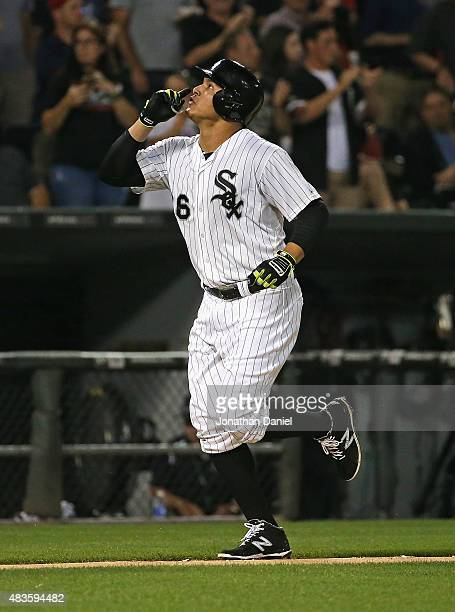 Avisail Garcia of the Chicago White Sox celebrates his solo home run in the 4th inning against the Los Angeles Angels at US Cellular Field on August...