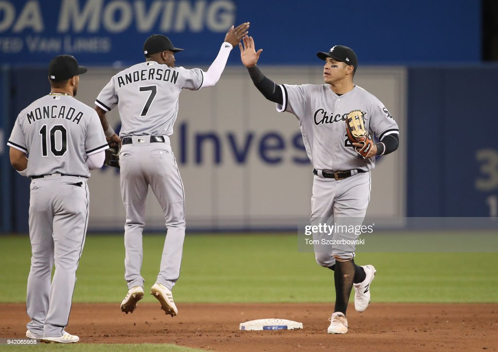Avisail Garcia #26 of the Chicago White Sox celebrates their victory with Tim Anderson #7 during MLB game action against the Toronto Blue Jays at Rogers Centre on April 4, 2018 in Toronto, Canada.