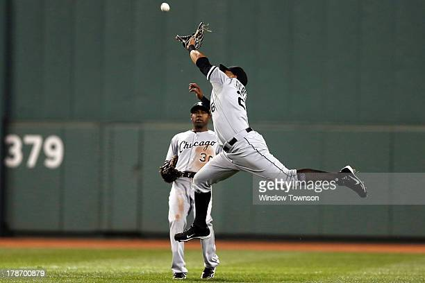 Avisail Garcia of the Chicago White Sox goes for a hit by Stephen Drew of the Boston Red Sox which fell for a single as Alejandro De Aza of the White...