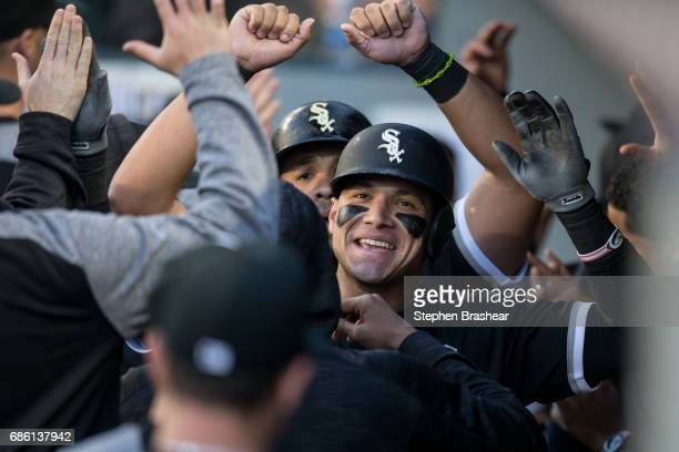 Avisail Garcia of the Chicago White Sox is congratulated by teammates in the dugout after hitting a threerun home run off of starting pitcher Yovani...