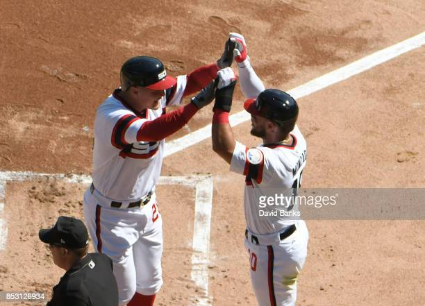 Avisail Garcia of the Chicago White Sox is greeted by Yoan Moncada after hitting a tworun homer against the Kansas City Royals during the first...