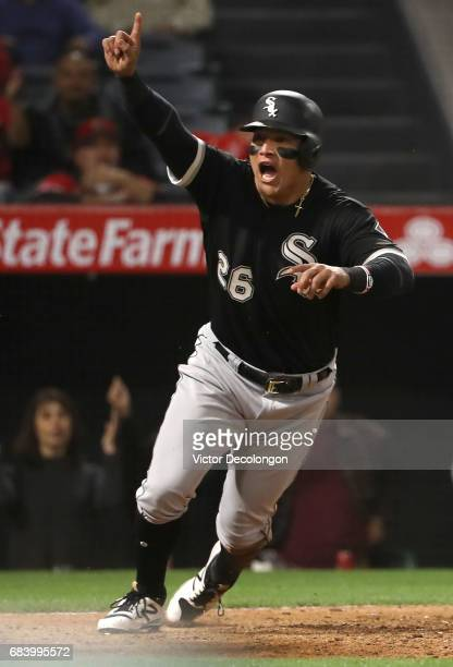 Avisail Garcia of the Chicago White Sox reacts after scoring the tying run in the ninth inning during the MLB game against the Los Angeles Angels of...