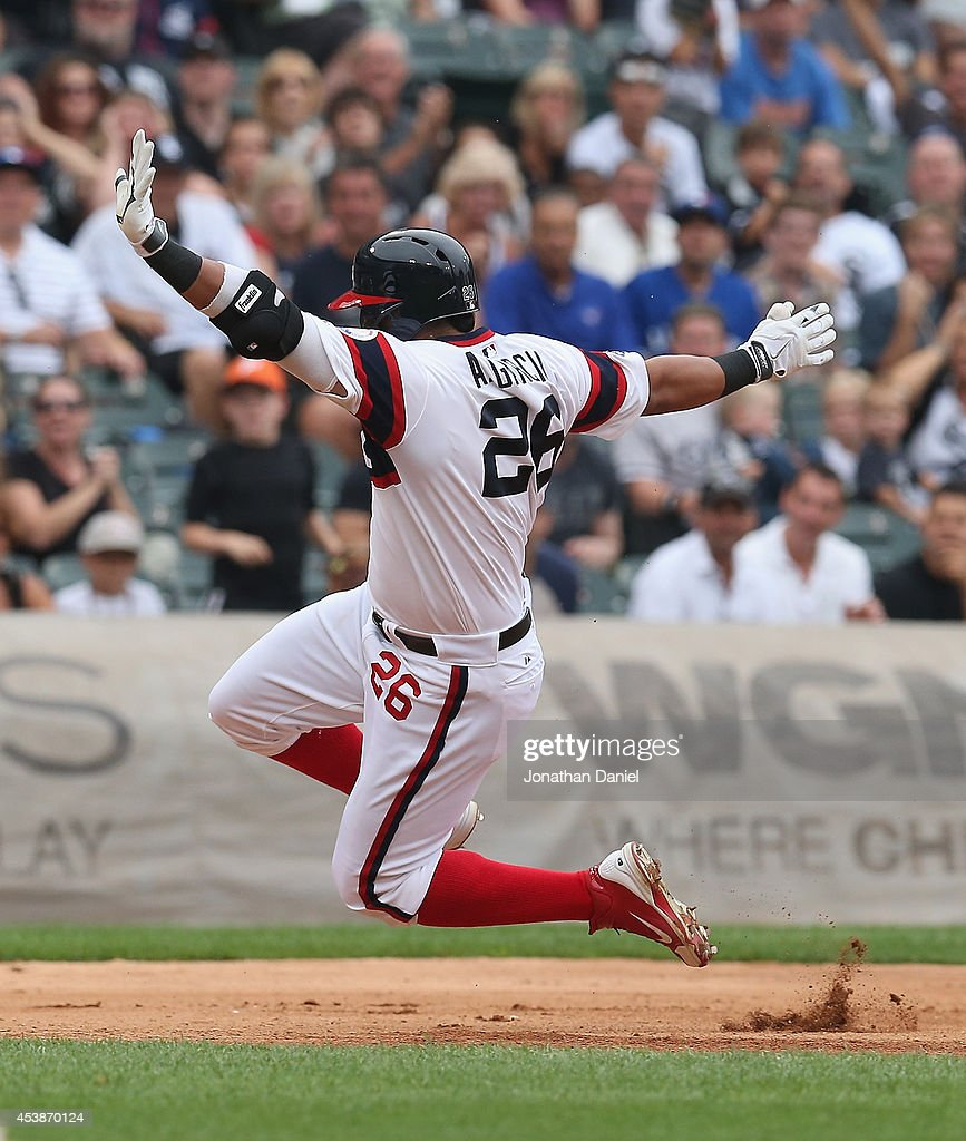 Avisail Garcia #26 of the Chicago White Sox runs to third base against the Toronto Blue Jays at U.S. Cellular Field on August 17, 2014 in Chicago, Illinois. The White Sox defeated the Blue Jays 7-5.
