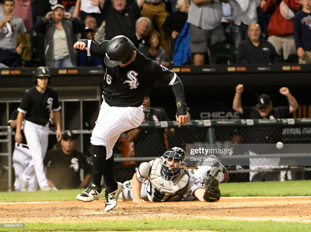 Avisail Garcia #26 of the Chicago White Sox scores the game-winning run as Jason Castro #21 of the Minnesota Twins tries to make a tag during the ninth inning on August 23, 2017 at Guaranteed Rate Field in Chicago, Illinois. The White Sox defeated the Twins 4-3.