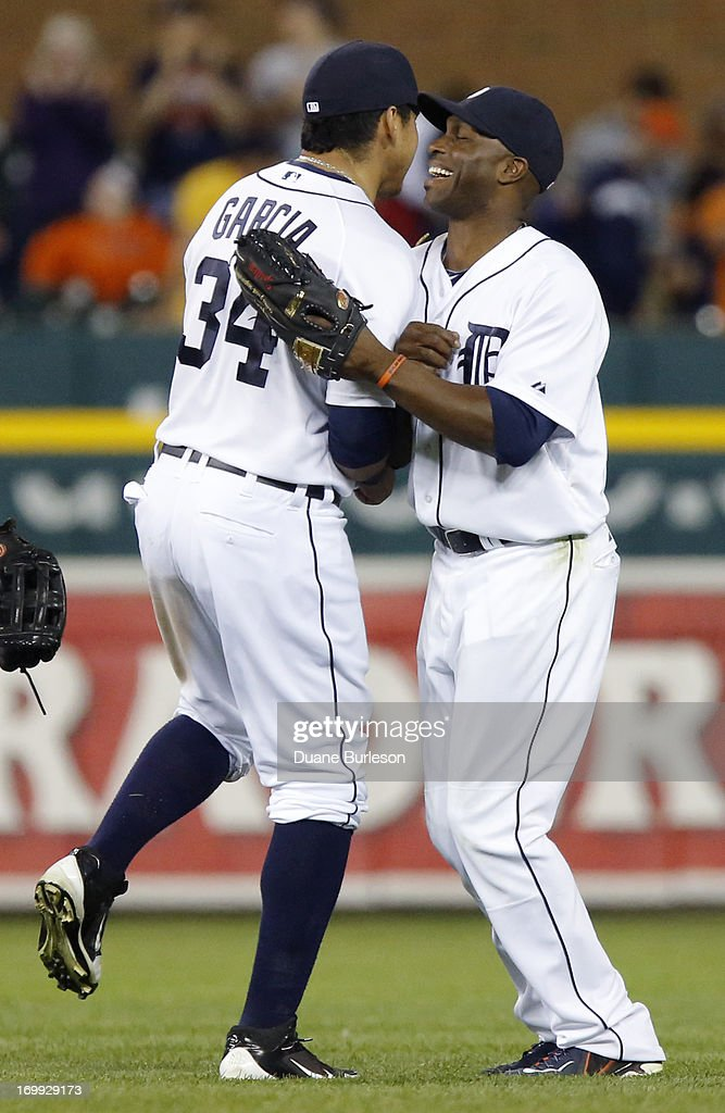 Avisail Garcia #34 of the Detroit Tigers and Torii Hunter #48 celebrate a 10-1 win over the Tampa Bay Rays at Comerica Park on June 4, 2013 in Detroit, Michigan.