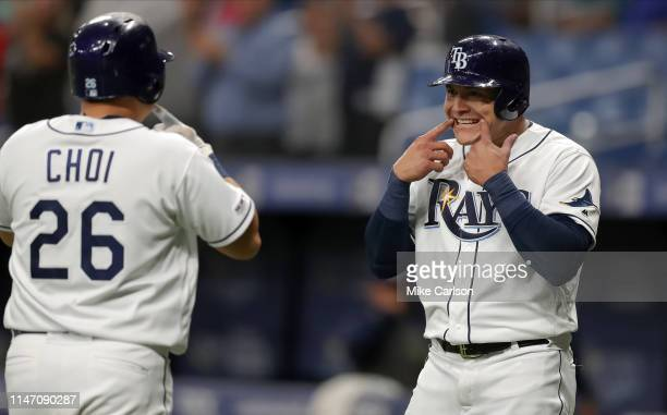 Avisail Garcia of the Tampa Bay Rays celebrates a home run by JiMan Choi in the seventh inning of a baseball game against the Minnesota Twins at...