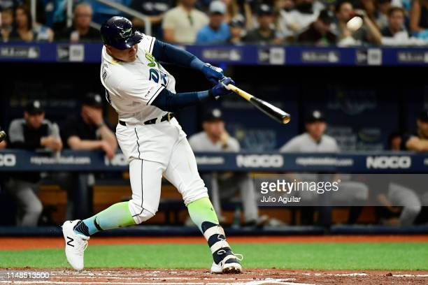 Avisail Garcia of the Tampa Bay Rays hits a home run off of CC Sabathia of the New York Yankees during the second inning at Tropicana Field on May 11...