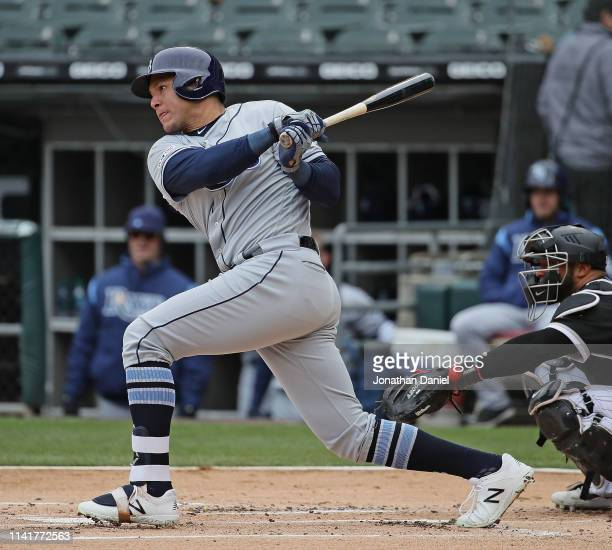 Avisail Garcia of the Tampa Bay Rays hits a single in the 1st inning against the Chicago White Sox at Guaranteed Rate Field on April 10 2019 in...