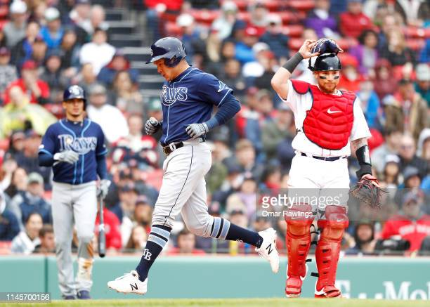 Avisail Garcia of the Tampa Bay Rays scores after a throwing error by second baseman Michael Chavis of the Boston Red Sox at Fenway Park on April 28...