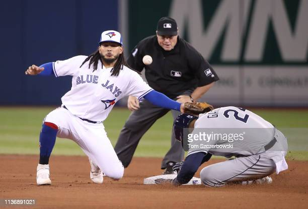Avisail Garcia of the Tampa Bay Rays slides safely into second base as he advances on a throwing error in the seventh inning during MLB game action...