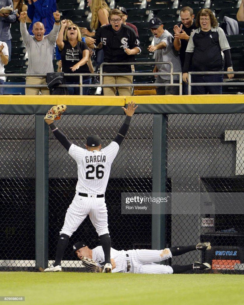 Avisail Garcia #26 reacts after Adam Engel #41of the Chicago White Sox leapt over the wall to take away a home run on a ball hit by Brian McCann #16 of the Houston Astros in the fourth inning on August 8, 2017 at Guaranteed Rate Field in Chicago, Illinois.