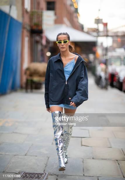 Avishag Nagar is seen wearing silver overknees boots, navy jacket, blue dress during New York Fashion Week September 2019 on September 08, 2019 in...
