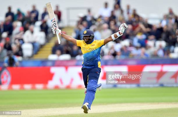 Avishka Fernando of Sri Lanka celebrates as he scores 100 runs during the Group Stage match of the ICC Cricket World Cup 2019 between Sri Lanka and...