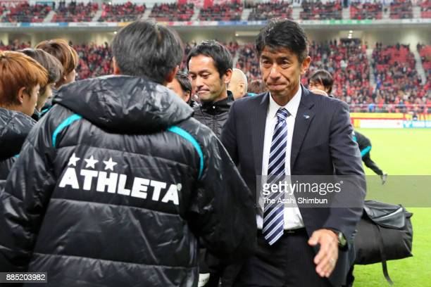 Avispa Fukuoka head coach Masami Ihara shakes hands with his team staffs after they missed the promotion to the J1 after the scoreless draw in the...