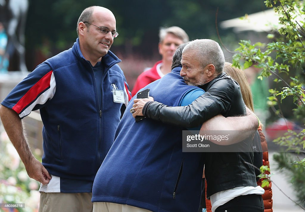 Aviv 'Vivi' Nevo (R), venture Capitalist with NV Investments, gets a hug from New Jersey Governor Chris Christie as Roberto Mignone, portfolio manager for Bridger Management, looks on at the Allen & Company Sun Valley Conference on July 11, 2015 in Sun Valley, Idaho. Many of the worlds wealthiest and most powerful business people from media, finance, and technology attend the annual week-long conference which is in its 33rd year.