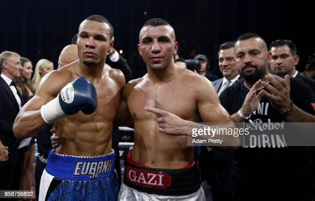Avni Yildirim of Turkey and Chris Eubank Jr of Great Britain pose after the Super Middleweight World Boxing Super Series fight at HannsMartinSchleyer...
