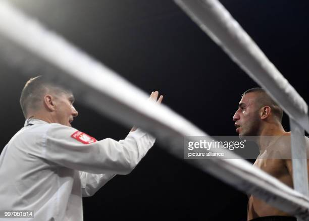 Avni Yildirim stands deafeted after his loss against Chris Eubank Jr at the super middleweight quarterfinals of the IBO Boxing World Cup in Stuttgart...