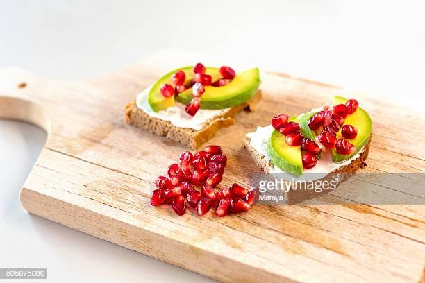 Avocado and pomegranates sandwich