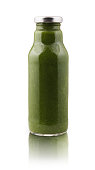 Avocado and spinach smoothie juice bottle isolated on white background