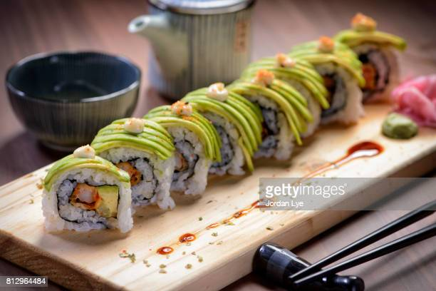 avocado caterpillar roll - sushi stock pictures, royalty-free photos & images