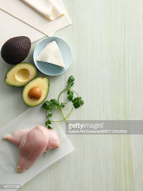 Avocado, cheese and raw chicken