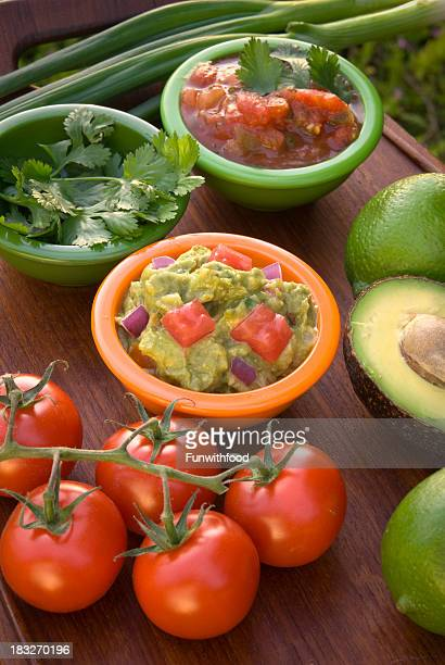 avocado guacamole dip & tomato mexican summer picnic snack food appetizer - mexican picnic stock pictures, royalty-free photos & images