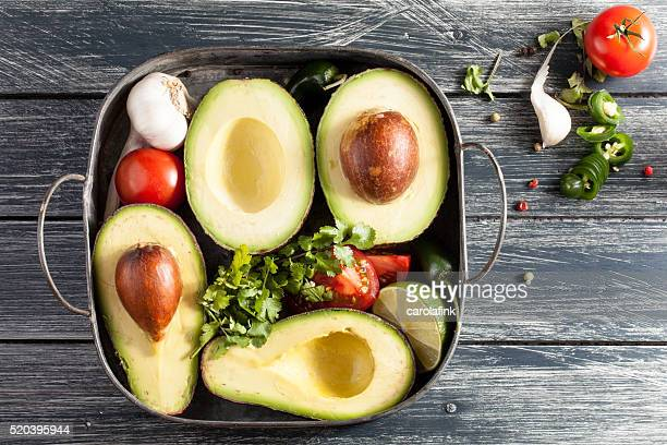 avocado in a basket - carolafink stock-fotos und bilder