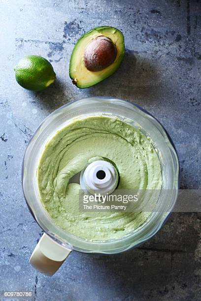 Avocado lime dressing in a food processor.Top view