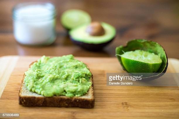 """avocado on toast - """"danielle donders"""" stock pictures, royalty-free photos & images"""