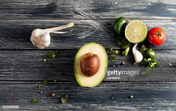 avocado on wooden board - carolafink stock pictures, royalty-free photos & images