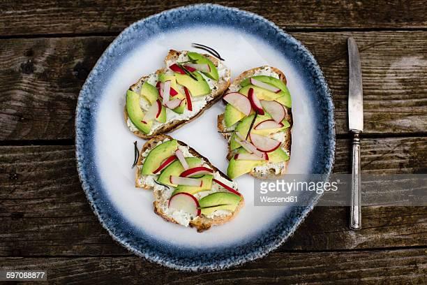 Avocado radish bread on plate