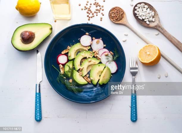 Avocado salad with radish and walnut