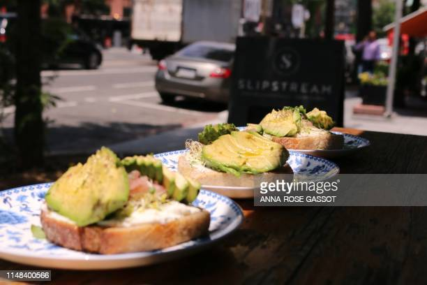 Avocado sandwiches are displayed at a restaurant on June 6 2019 in WashingtonDC US President Donald Trump has trumpeted the robust US economy but...