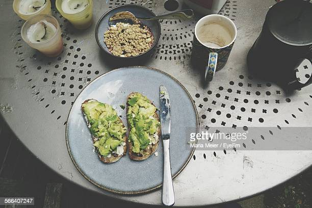 Avocado Sliced On Toasted Bread On Plate And Granola