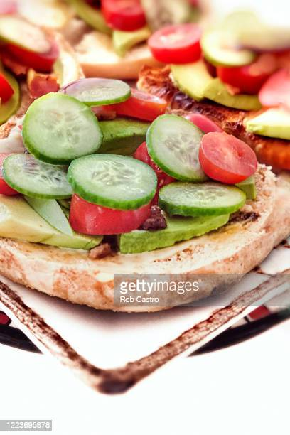 avocado toast - rob castro stock pictures, royalty-free photos & images