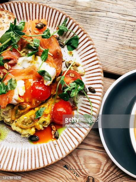 avocado toast with salmon, poached egg and tomatoes, high angle view - lunch stock pictures, royalty-free photos & images