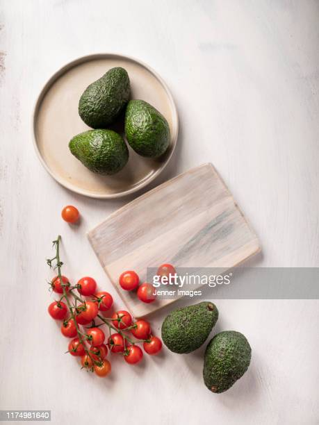 avocados and tomatoes. - vegan food stock pictures, royalty-free photos & images