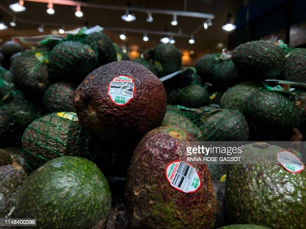 Avocados from Mexico are seen for sale in a store on June 6 2019 in WashingtonDC US President Donald Trump has trumpeted the robust US economy but...