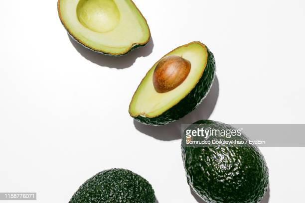 avocados on white background - avocado stock pictures, royalty-free photos & images