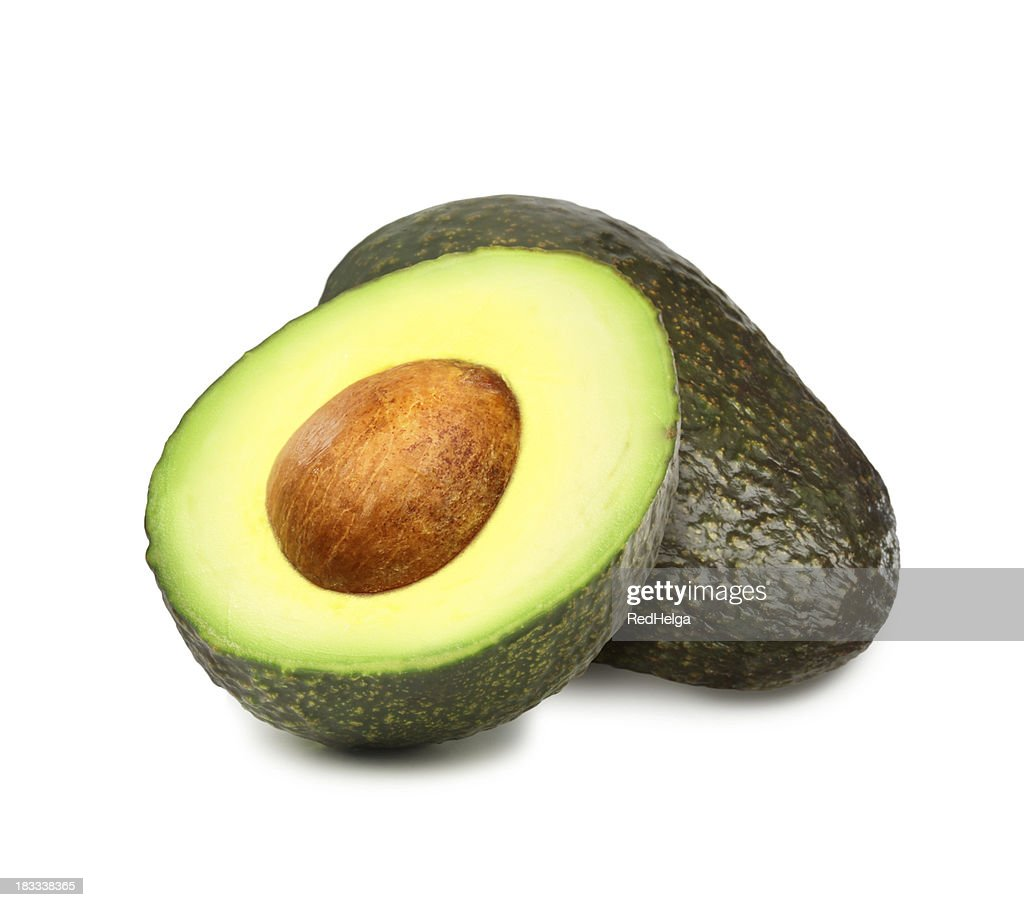 Avocados with pit : Stock Photo