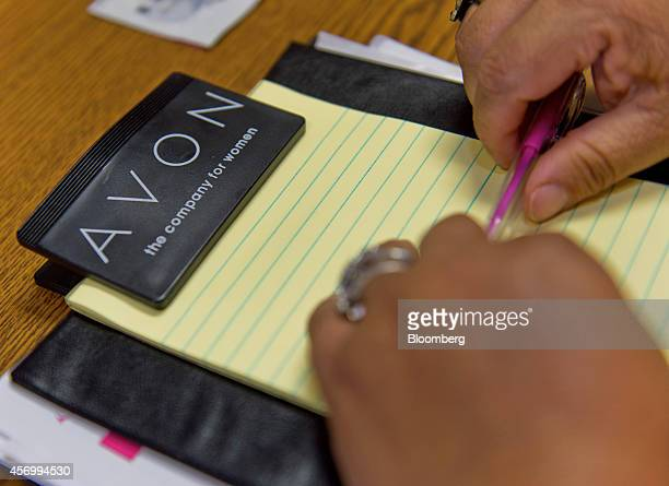 Avon Products Inc signage is seen on the clipboard of a representative in McAllen Texas US on Thursday Aug 28 2014 The top 10 US Avon districts are...