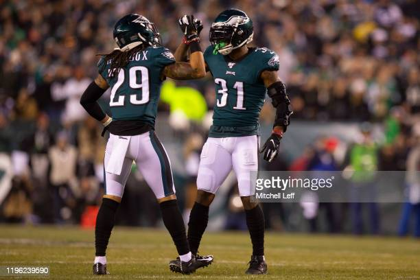 Avonte Maddox and Jalen Mills of the Philadelphia Eagles react against the Dallas Cowboys at Lincoln Financial Field on December 22 2019 in...