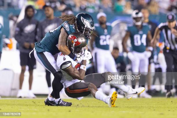 Avonte Maddox of the Philadelphia Eagles tackles Antonio Brown of the Tampa Bay Buccaneers at Lincoln Financial Field on October 14, 2021 in...