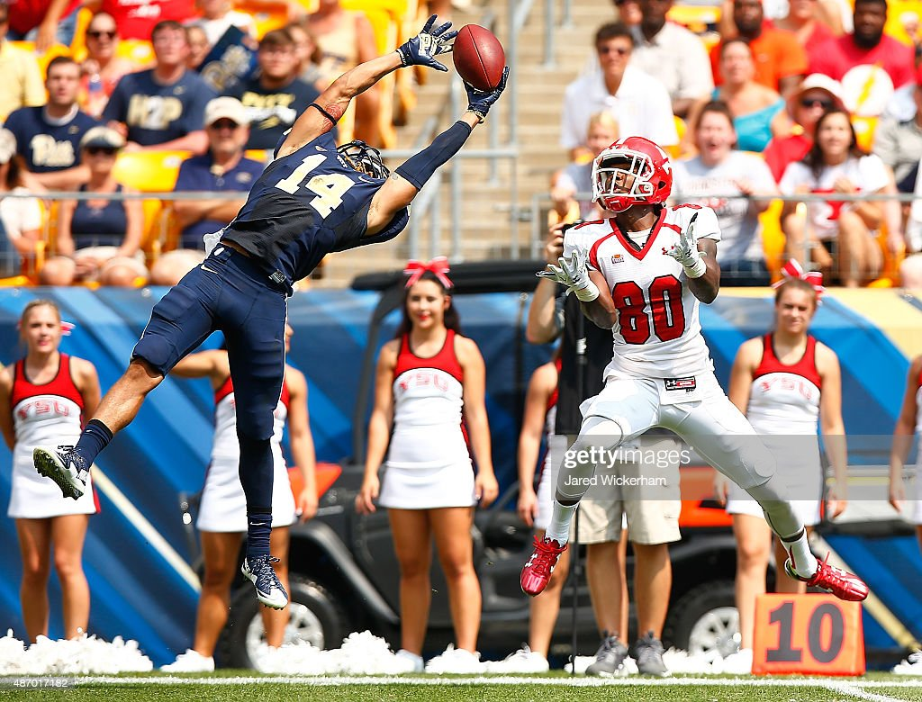Avonte Maddox #14 of the Pittsburgh Panthers breaks up a pass in front of Andrew Williams #80 of the Youngstown State Penguins in the first half during the game at Heinz Field on September 5, 2015 in Pittsburgh, Pennsylvania.