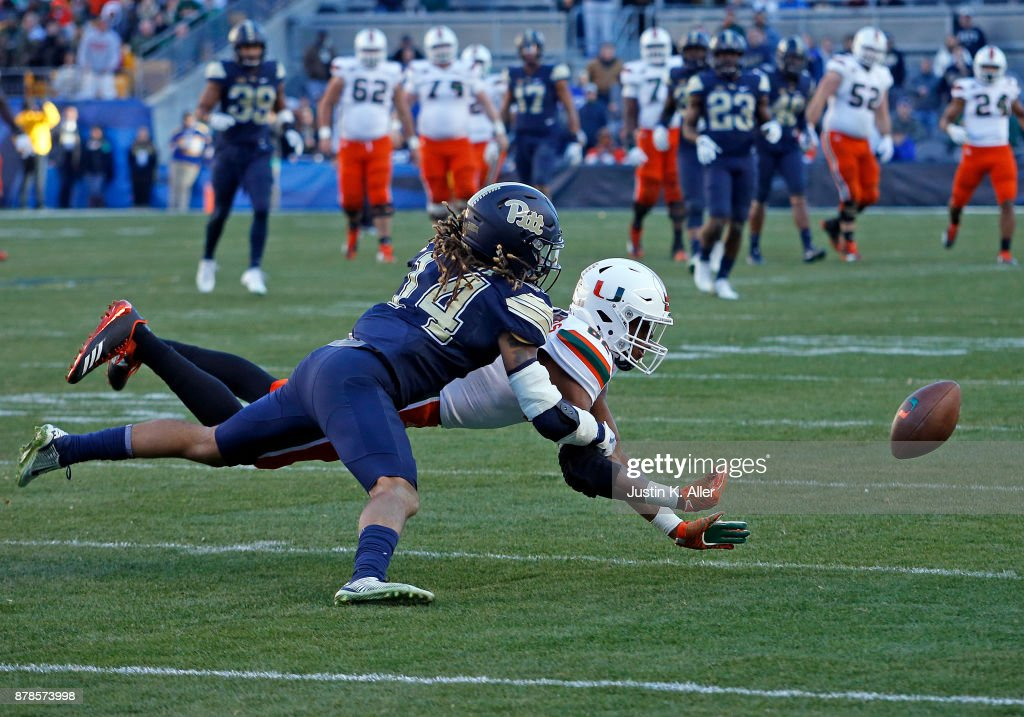 Avonte Maddox #14 of the Pittsburgh Panthers defends against Ahmmon Richards #82 of the Miami Hurricanes on November 24, 2017 at Heinz Field in Pittsburgh, Pennsylvania.