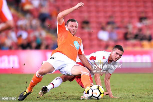 Avraam Papadopoulos of the Roar and George Blackwood of Adelaide compete for the ball during the round 22 ALeague match between the Brisbane Roar and...