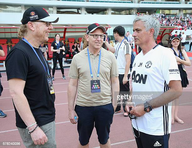 Avram Glazer and Joel Glazer speak to Manager Jose Mourinho of Manchester United during a first team training session as part of their pre-season...