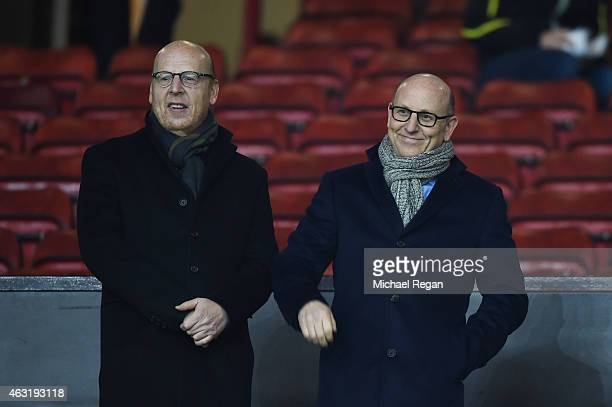 Avram Glazer and Joel Glazer, the Co-Chairmen of Manchester United look on during the Barclays Premier League match between Manchester United and...