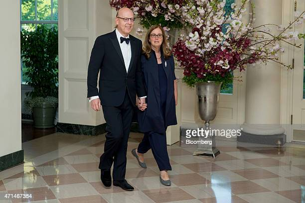 Avram Glazer, co-chairman of Manchester United Plc, left, and Jill Glazer arrive at a state dinner hosted by U.S. President Barack Obama and U.S....