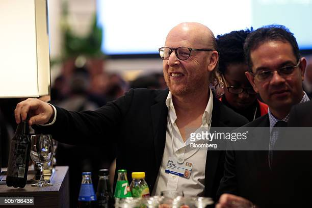 Avram Glazer, co-chairman of Manchester United Plc, takes a refreshment between sessions during the World Economic Forum in Davos, Switzerland, on...